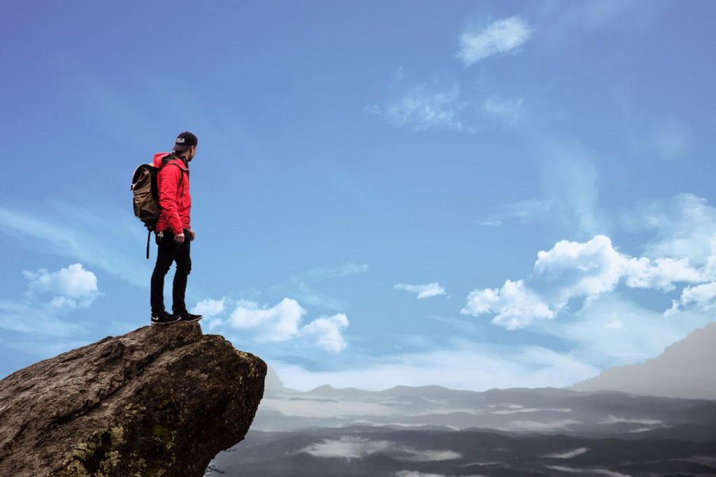 Auf diesem Bild sieht man einen Mann der auf einem Felsen steht und in die Ferne blickt. Er denkt darüner nach welchen Sinn sein Leben hat, weil er seinen Liebeskummer überwinden möchte.